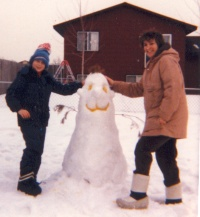 Picture of my mom and me making a snowman